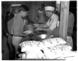 Internees in food line at Camp Harmony, Puyallup, 1942
