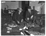 Luke May (left) and Daniel Blankenship examining a murder scene, Bremerton, 1934