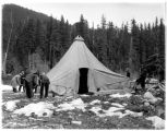 Men setting up tent at campsite, Civilian Conservation Corps, Longmire, ca. 1937