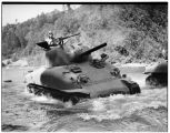 Man test driving Sherman tank in river, Renton, 1942