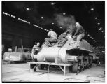 Workers building tanks at Pacific Car and Foundry factory, Renton, 1943