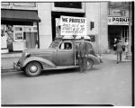Car with sign protesting use of prisoner-of-war labor, Septemeber 1945