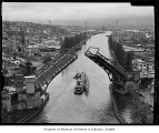 Training submarine Puffer and tugs Trojan and Neptune in the Lake Washington Ship Canal with the...