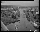 Aerial of yachts parading through Montlake Cut on opening day of boating season, looking west,...