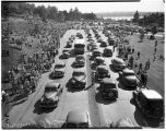 Parade of vehicles celebrating the end of Lake Washington floating bridge tolls, July 2, 1949