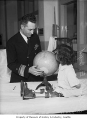 Explorer Richard E. Byrd visiting a girl in a Seattle hospital, May 1946