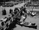 Crowds and canoes at the waterfront in Leschi Park, ca. 1911