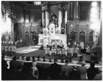 St. James Cathedral altar during a service, Seattle, ca. 1945