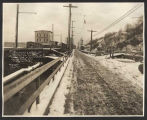 View of street and flour mill, looking southeast on Alki Avenue, March 19, 1913