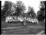 Large group of children on a seesaw in Volunteer Park, ca. 1909