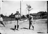 Boys playing baseball, ca. 1910