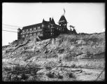 The Washington Hotel during the Second Avenue Regrade, ca. 1906