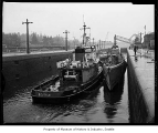 Training submarine Puffer and the tug Neptune in the Chittenden locks, Seattle, 1960