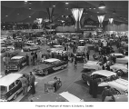 Cars on display at Seattle Auto Show, Seattle, 1956