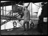 Charles K. Hamilton and his Curtiss biplane, March 1910