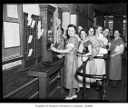 Bemis Bag Co. employees at time clock, Seattle, 1937