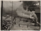 Firemen and hoses at the Grand Trunk Pacific Dock fire, July 30, 1914