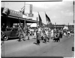 Scout troop marching in parade at Kent, Washington, July 27, 1946