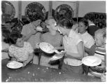 Girls' cake eating contest, Kent Community Festival, July 13, 1956