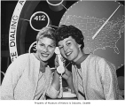 Sonya Beck and Pat Beam demonstrating direct dialing in Bell System exhibit, Seattle World's Fair,...