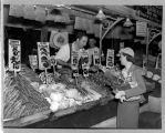 Prudence Penny buying vegetables at Pike Place Market, ca. 1940