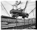 Truck being loaded onto ship, Seattle, 1949