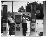 Mayor Wiseman at his service station, July 1940