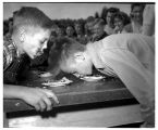 Two boys in a pie-eating contest, September 6, 1947