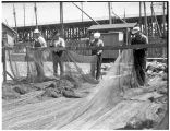 Men working on fishing nets at Salmon Bay Terminal, October 1935