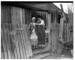 Snoqualmie couple standing outside their home, February 1939