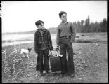 Two Klallam boys carrying clams, February 1939