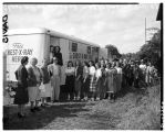 Group waiting for chest x-ray outside mobile unit, September 15, 1948