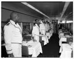 Uniformed dining car waiters on the Empire Builder, February 1947
