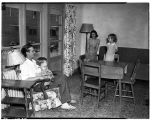 Acor family in Yesler Terrace apartment, ca. 1940