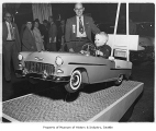 Boy in model Chevrolet Bel Air at Seattle Auto Show, Seattle, 1955
