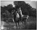 Newspaper carrier on horseback,  June 1942