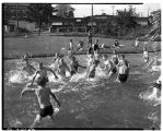 Children playing in a wading pool at Green Lake Park, June 1937