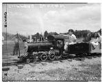 Boy riding on miniature train, July 22, 1947
