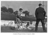 Seattle Rainiers player sliding into base, Seattle, 1940