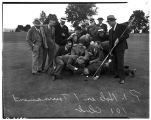 101 Club golfers posing by prize hole, July 9, 1939