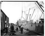 Men unloading cargo from ship, ca. 1935