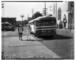 Strikers picketing near Greyhound bus, June 18, 1949