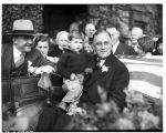 Franklin D. Roosevelt holding a small boy, September 20, 1932