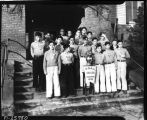 Soccer team with championship pennant, ca. January 1936