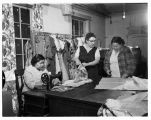 Three women working in the Thrift Shop at Tulalip Indian Reservation Community Hall, 1962