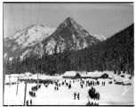 People in the snow at the summit of Snoqualmie Pass, January 1931