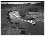 Outboard motorboats racing in the Sammamish River, January 1941