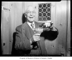 Charles Thorndike pouring a glass of beer at Rainier Brewery, Seattle, 1949