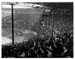 Crowds in baseball stadium on opening day, May  1943