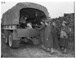 Mr. and Mrs. Moji in back of military truck, March 30, 1942